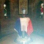 The French flag draped over the font at All Saints on November 15.